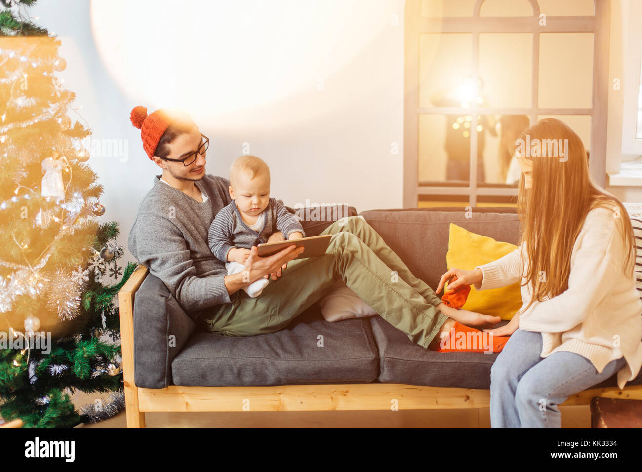 happy father and son with tablet pc computer playing at home - Stock Image