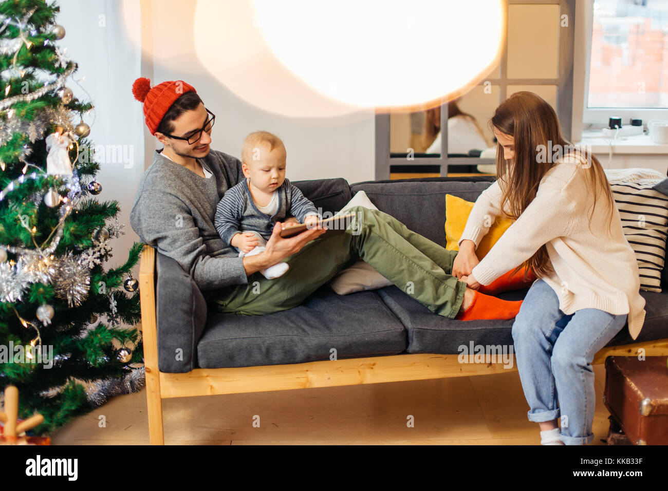 happy father and son with tablet pc computer playing at home Stock Photo