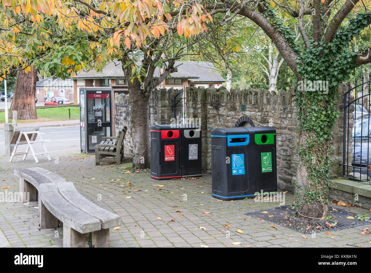 Recycling bins on a pavement in Builth Wells, Powys, Wales, UK. Stock Photo