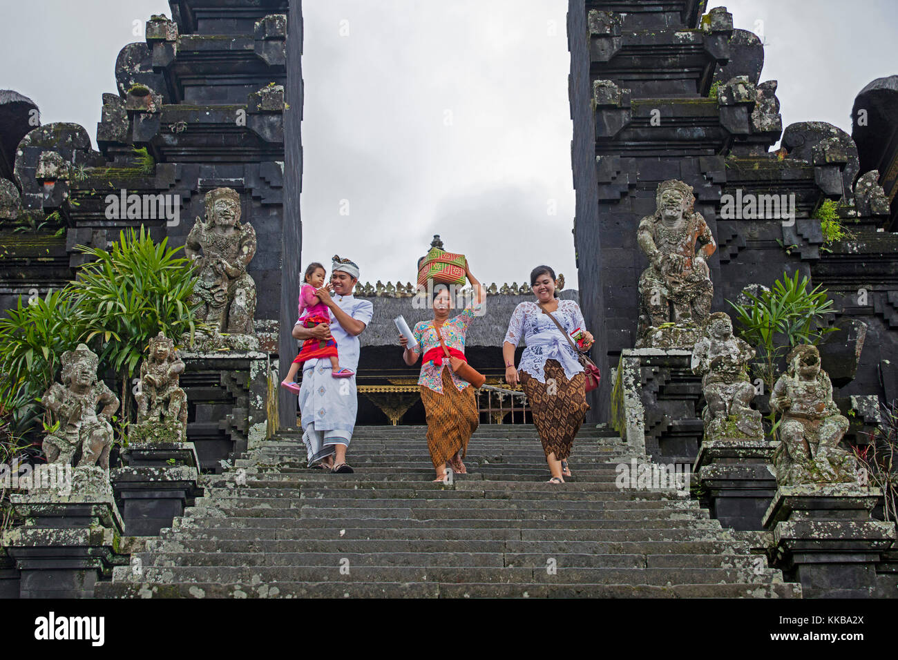 Indonesian tourists visiting Pura Besakih, largest and holiest temple of Hindu religion in Bali on the slopes of - Stock Image