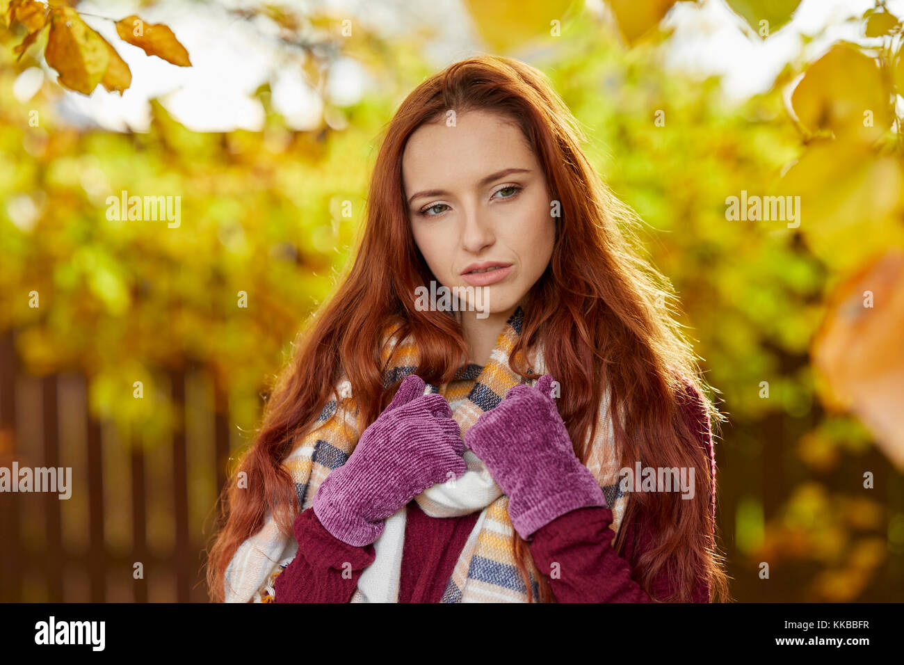 Girl looking concerned outdoors - Stock Image
