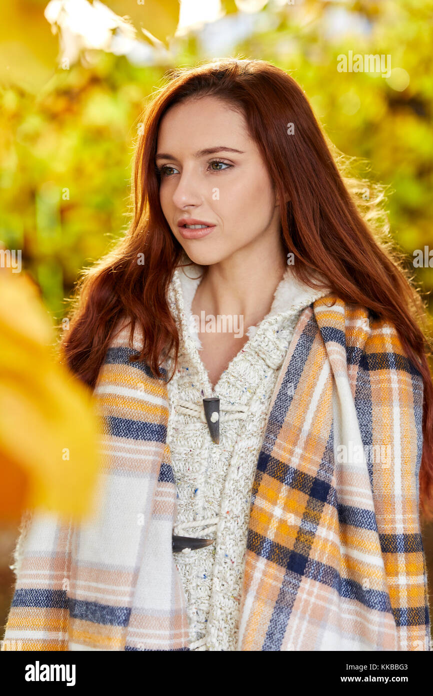 Concerned looking girl outdoors - Stock Image