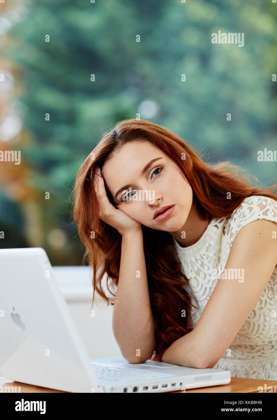 Girl bored at work - Stock Image