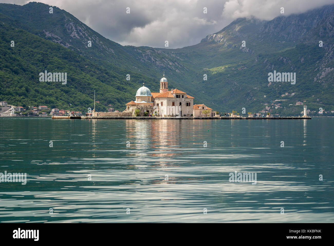 Our Lady of the Rocks church taken from a boat sailing in the Bay of Kotor, Montenegro. - Stock Image