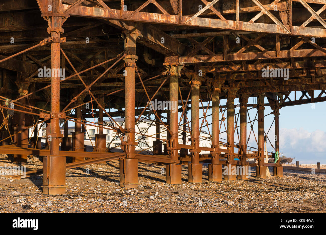Rusting metal support struts on a pier, after corrosion by sea water. - Stock Image
