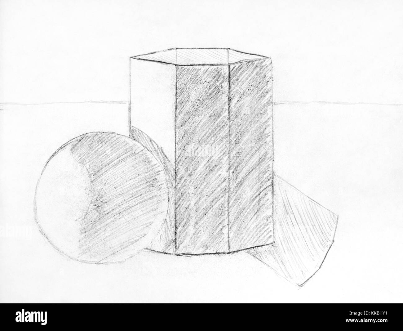 Child pencil drawing of geometric figures- sphere and hexahedron. Close-up. - Stock Image