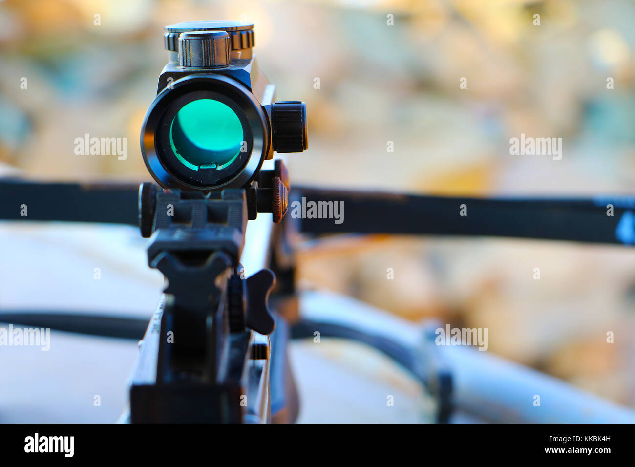 Crossbow optical sight  aiming from the first person on defocused blurred background - Stock Image