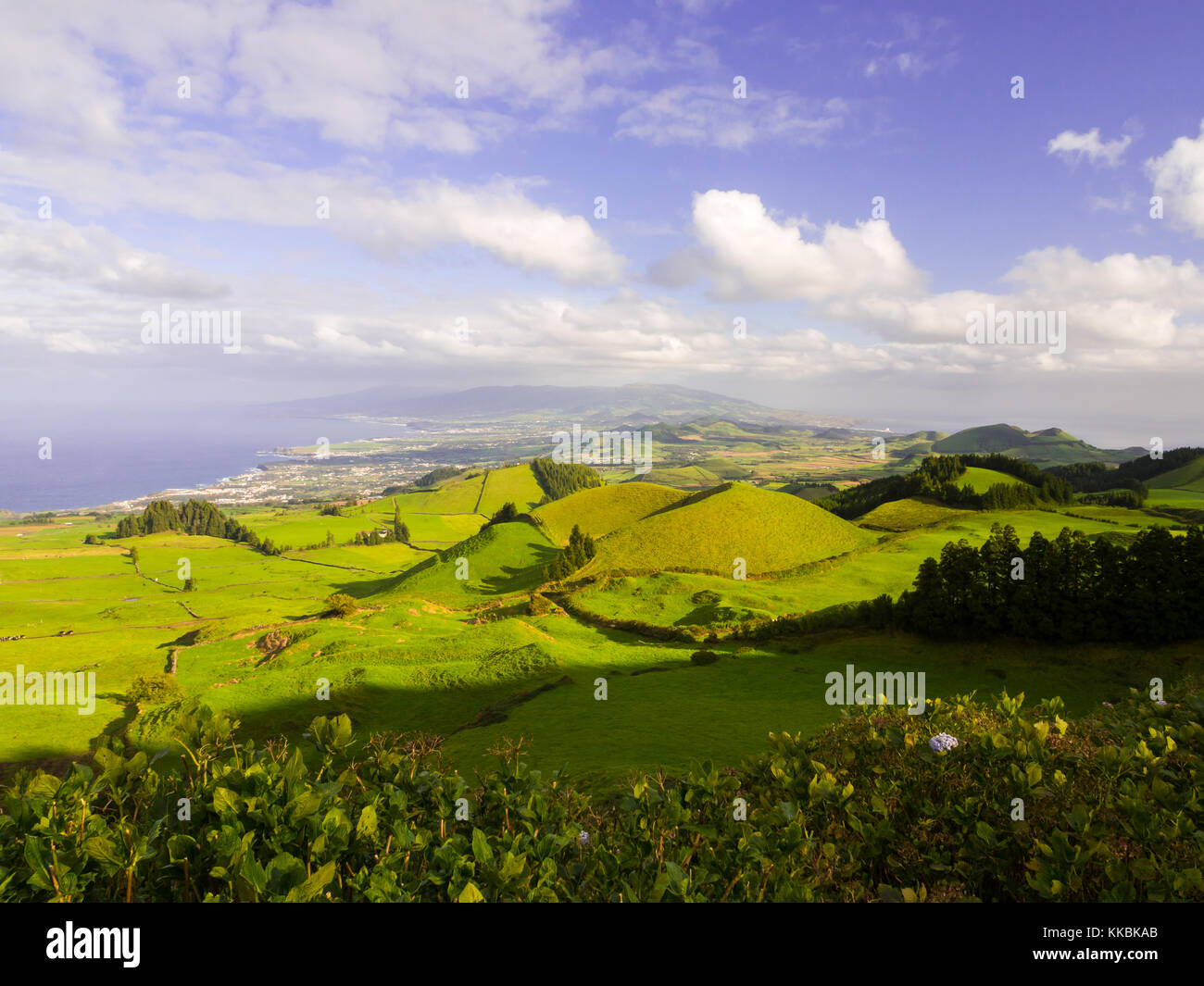 Landscape in Sao Miguel Island, Azores, Portugal, as seen from Coal Peak viewpoint. Capelas and Ponta Delgada in - Stock Image