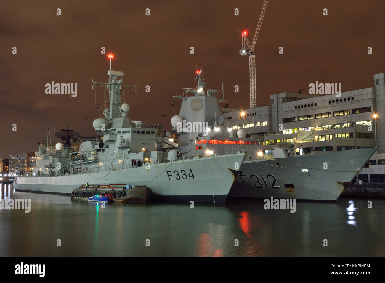 Two Frigates of NATO's SNMG1 paying a port-call to London seen moored in West India Dock in Canary Wharf, London - Stock Image
