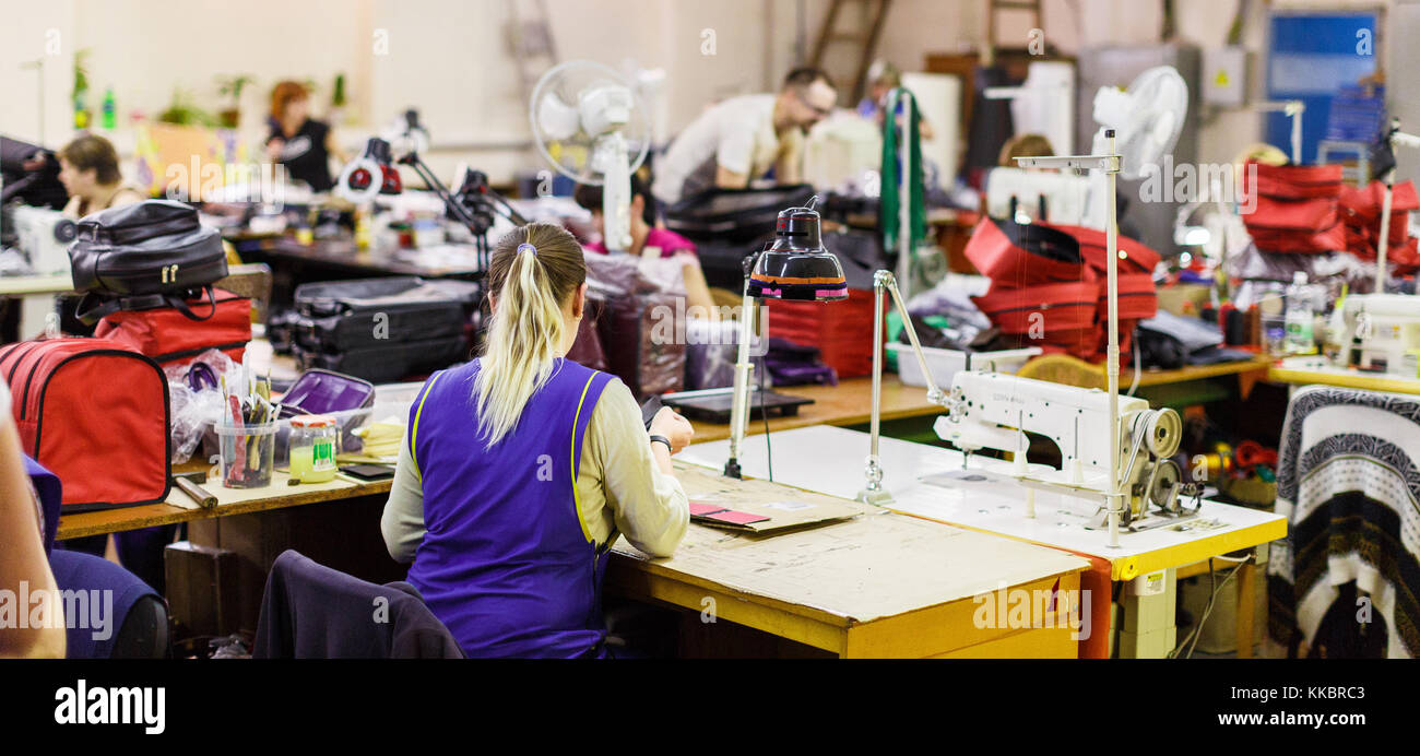woman manufacturing bags - Stock Image