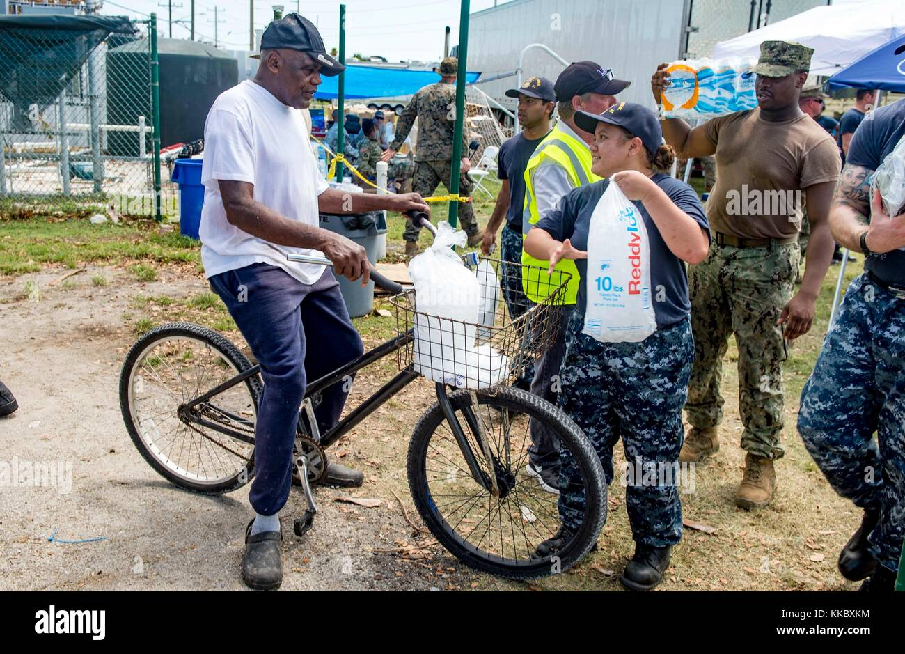 U.S. Navy sailors deliver emergency supplies to local residents during relief efforts in the aftermath of Hurricane - Stock Image