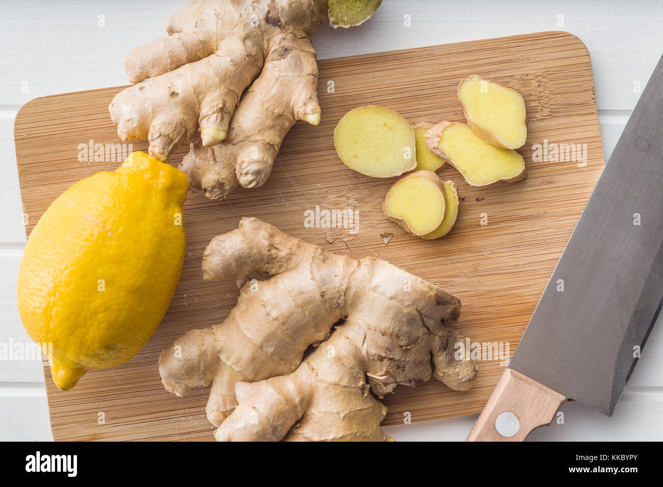 Sliced ginger root and yellow lemon. - Stock Image