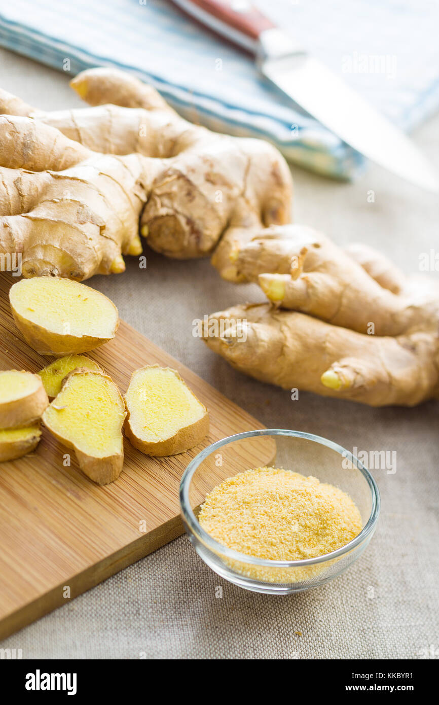Dried and fresh ginger root on kitchen table. - Stock Image