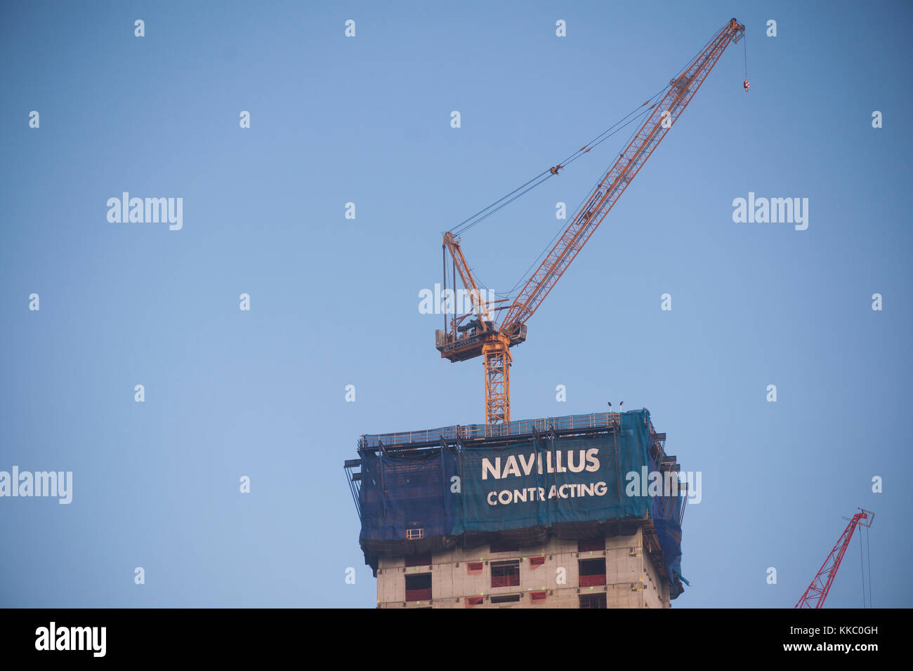 A banner for Navillus Contracting atop Brookfield's Manhattan West development in New York on Sunday, November - Stock Image