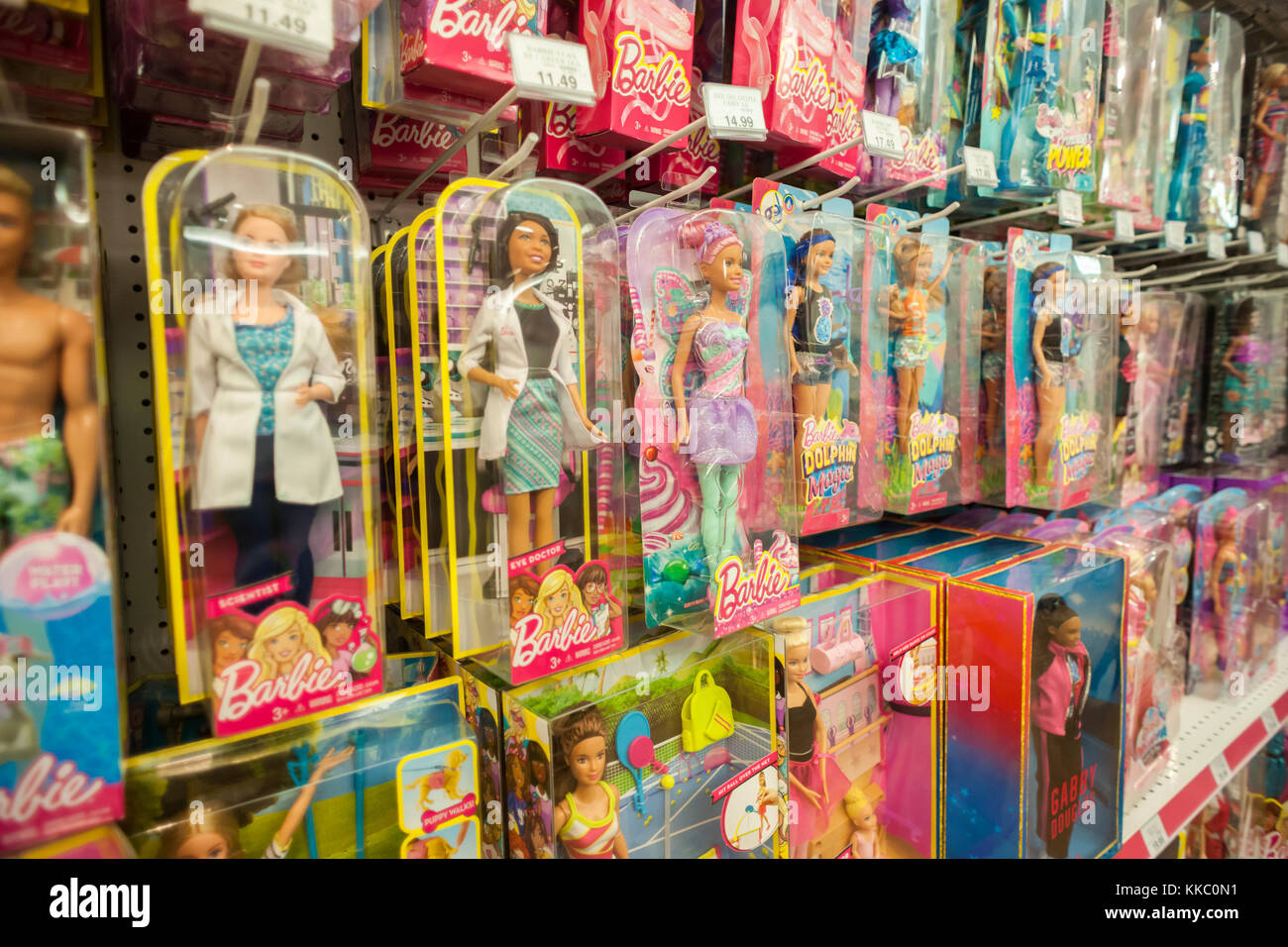 A selection of Mattel Barbie Dolls in the Toys R Us location in Times Square in New York on Sunday, November 26, Stock Photo