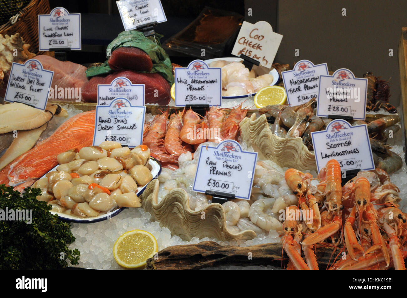 A selection of beautiful fresh wet fish in a colourful display on a fishmongers stall at Borough market in London, - Stock Image