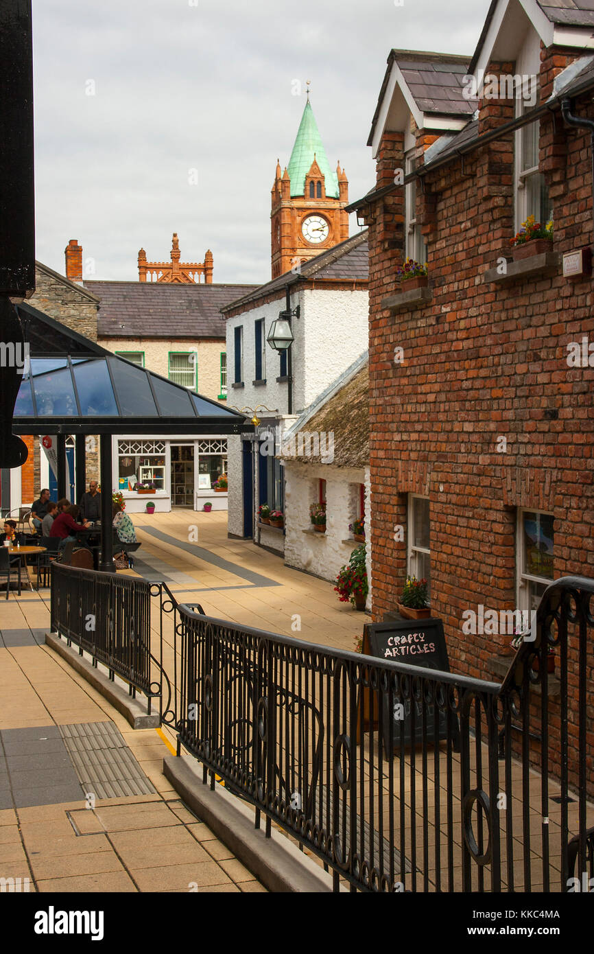 A footpath with handrail leading to shops in the craft village inside the walls of the maiden city of Londonderry - Stock Image