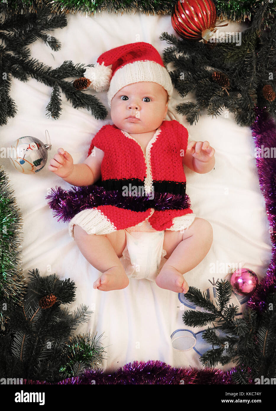 Baby first christmas. Beautiful little baby in Santa hat and jacket  celebrates Christmas. New 2b20837bb67a