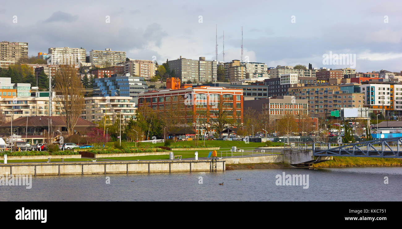 Seattle city neighborhood at Lake Union waterfront, USA. Colorful residential and office buildings after the rain. - Stock Image