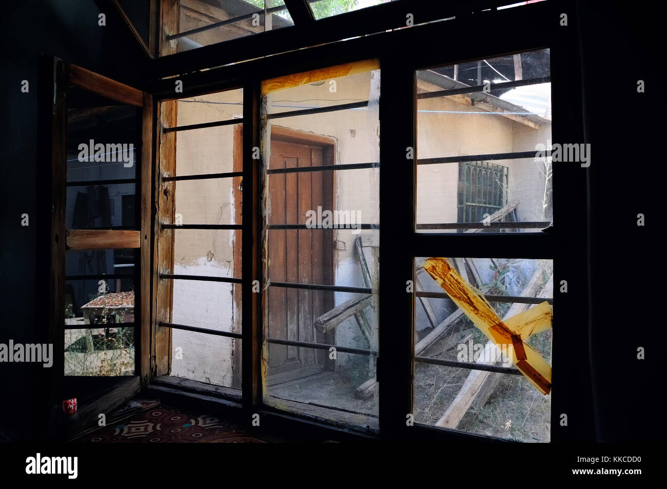 ruin home, old window - Stock Image