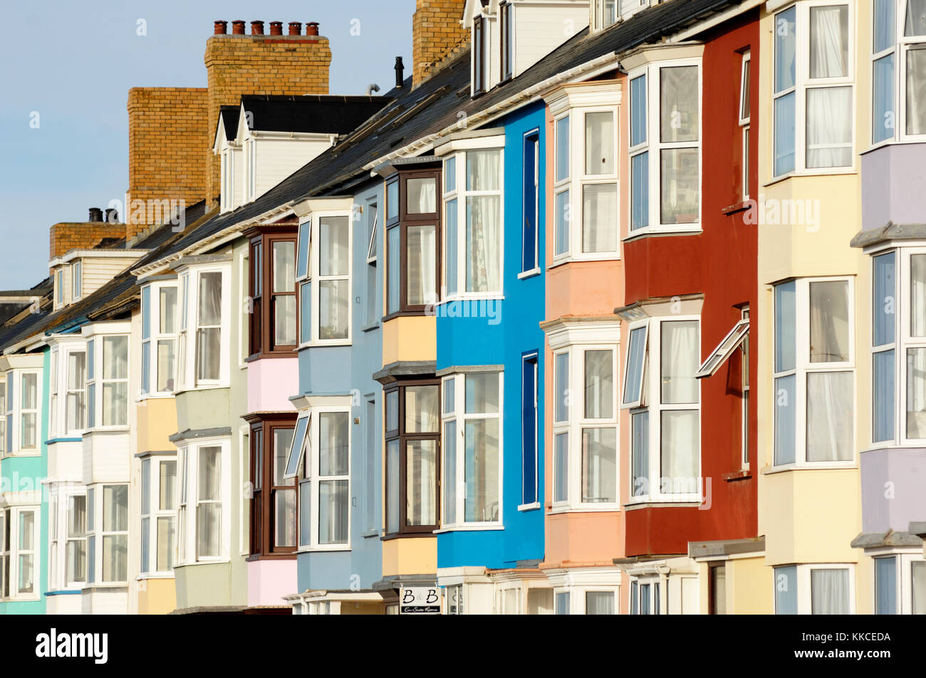 Brightly coloured seafront housing in Aberystwyth, Wales Stock Photo