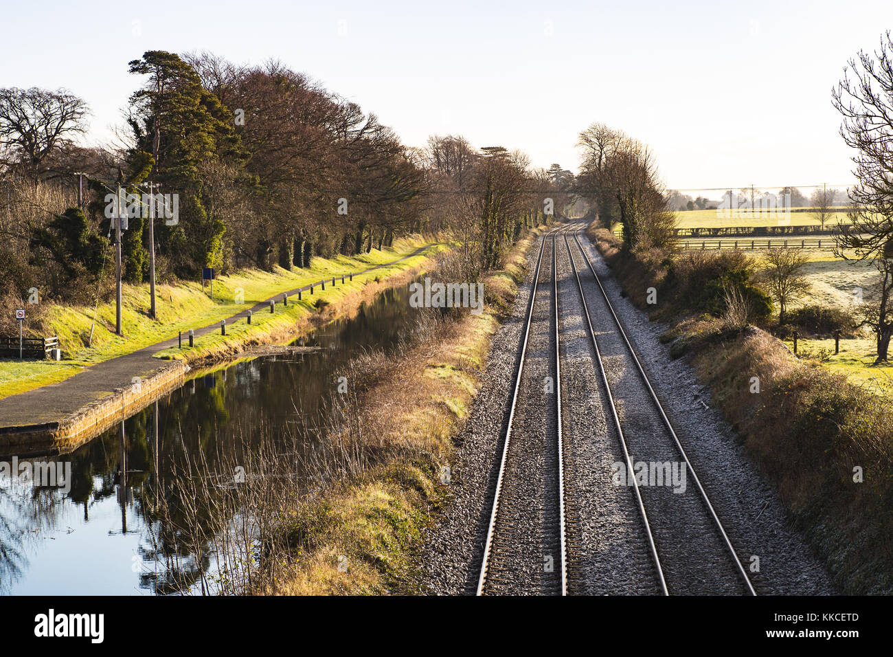 Dart rail track running by the Royal Canal in Maynooth, County Kildare, Ireland - Stock Image