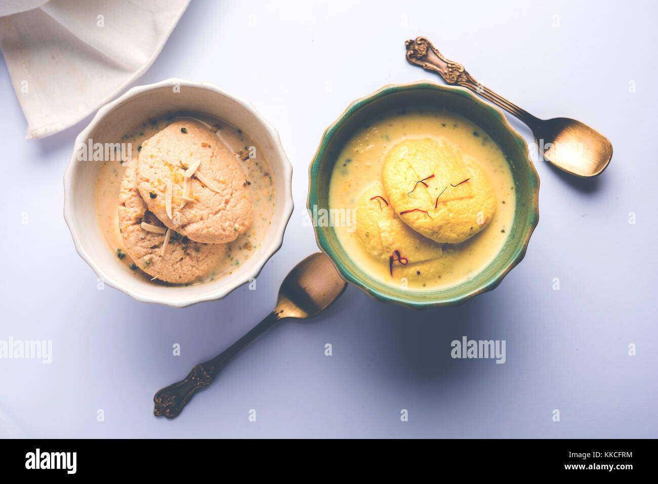 Ras malai or Rasmalai or rossomalai is Indian dessert food made using Jaggery or gur and sugar. It is a rich cheesecake - Stock Image
