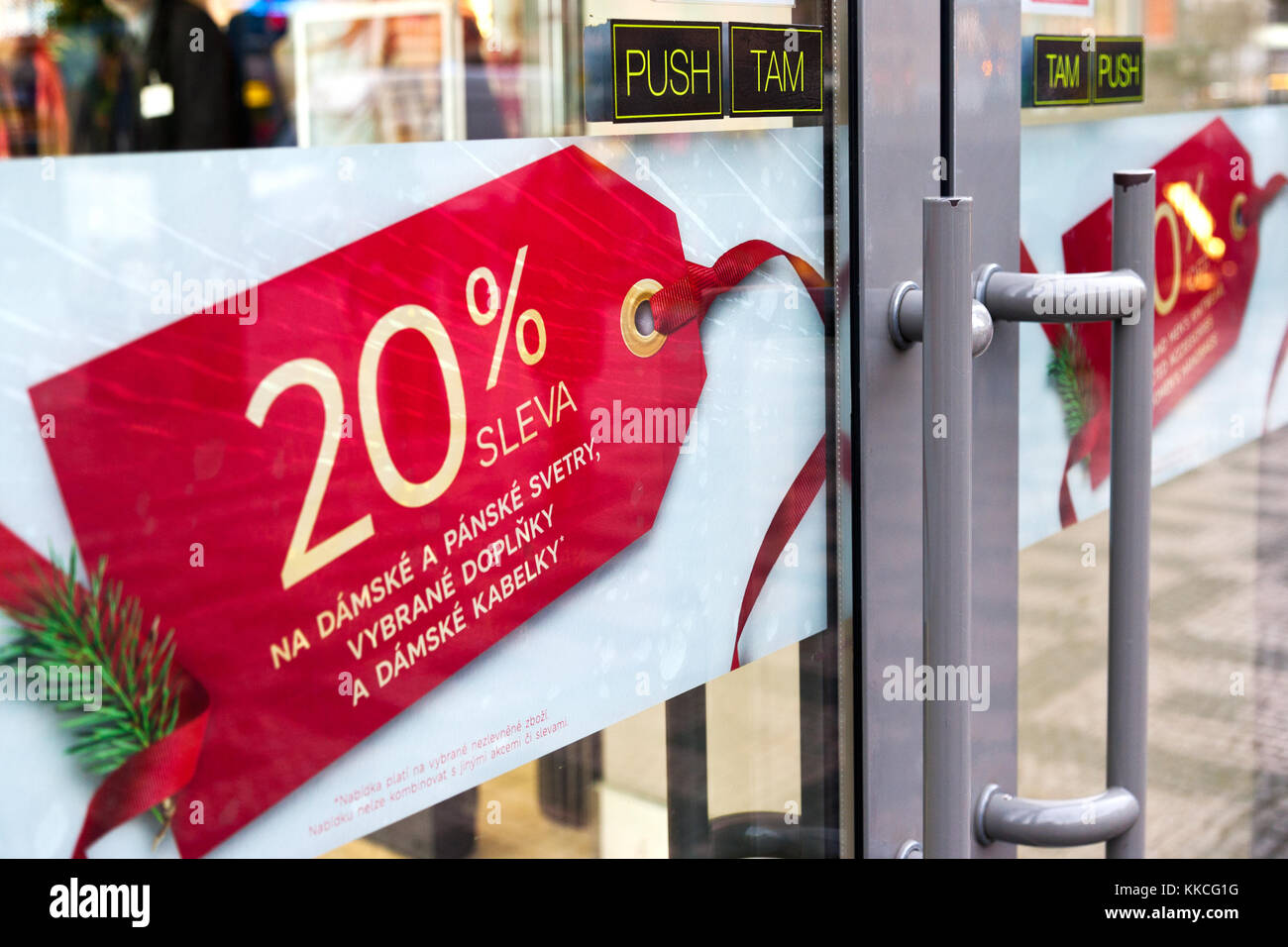 czech shopping - sale and discount - doors into a shop with sale sign - Stock Image