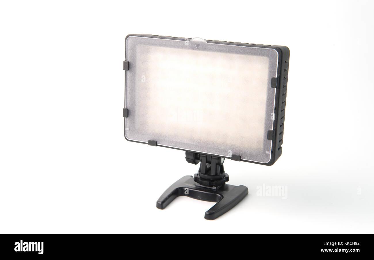 Unlit LED camera light on stand against white background - Stock Image