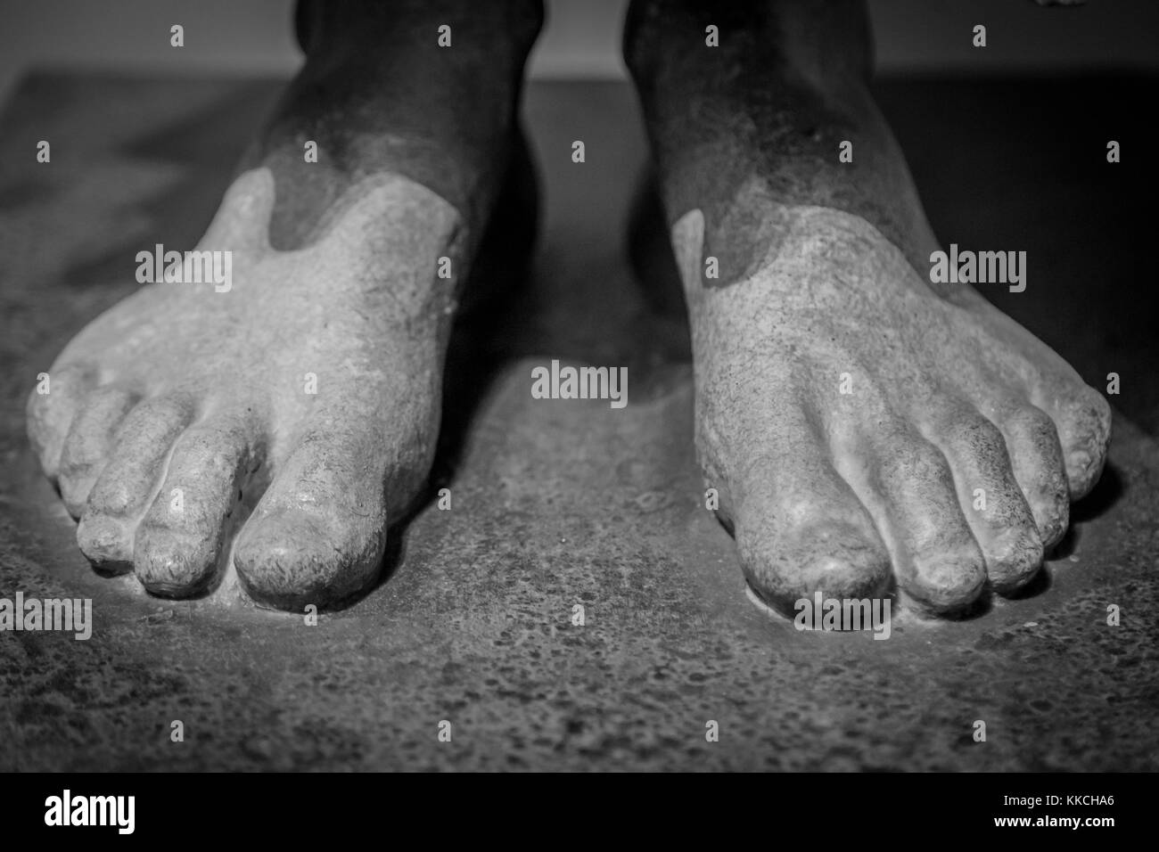 Feet of an ancient statue - Stock Image