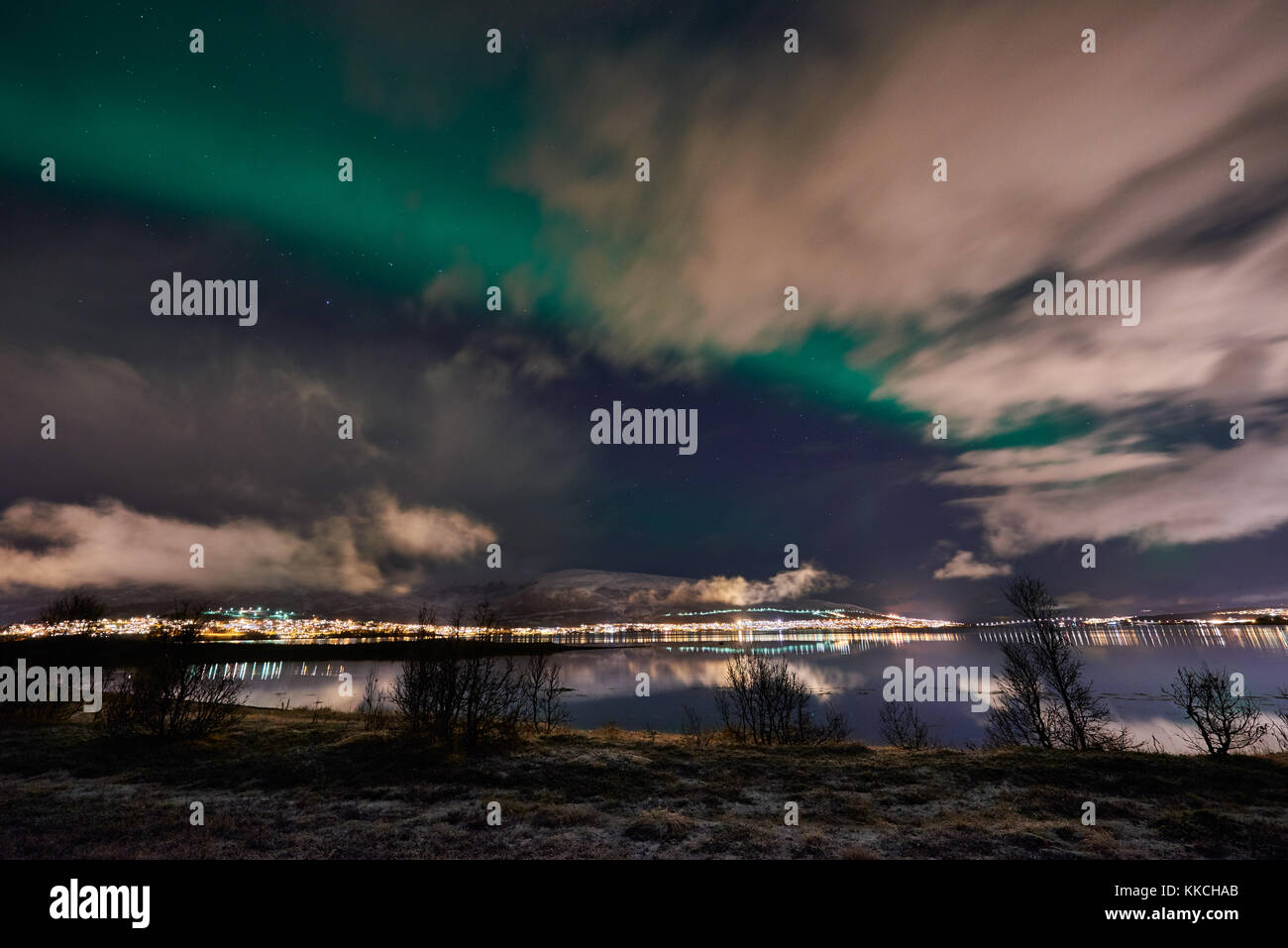 Aurora Borealis or northern lights over winter landscape of Tromso, Troms, Norway, Europe - Stock Image