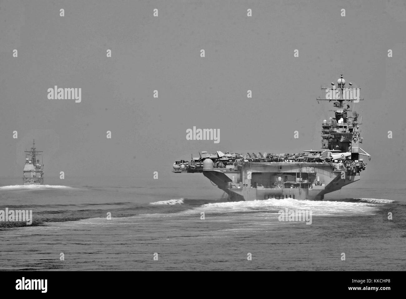 The guided-missile cruiser USS Cape St George CG 71 and the aircraft carrier USS Abraham Lincoln CVN 72 transit - Stock Image