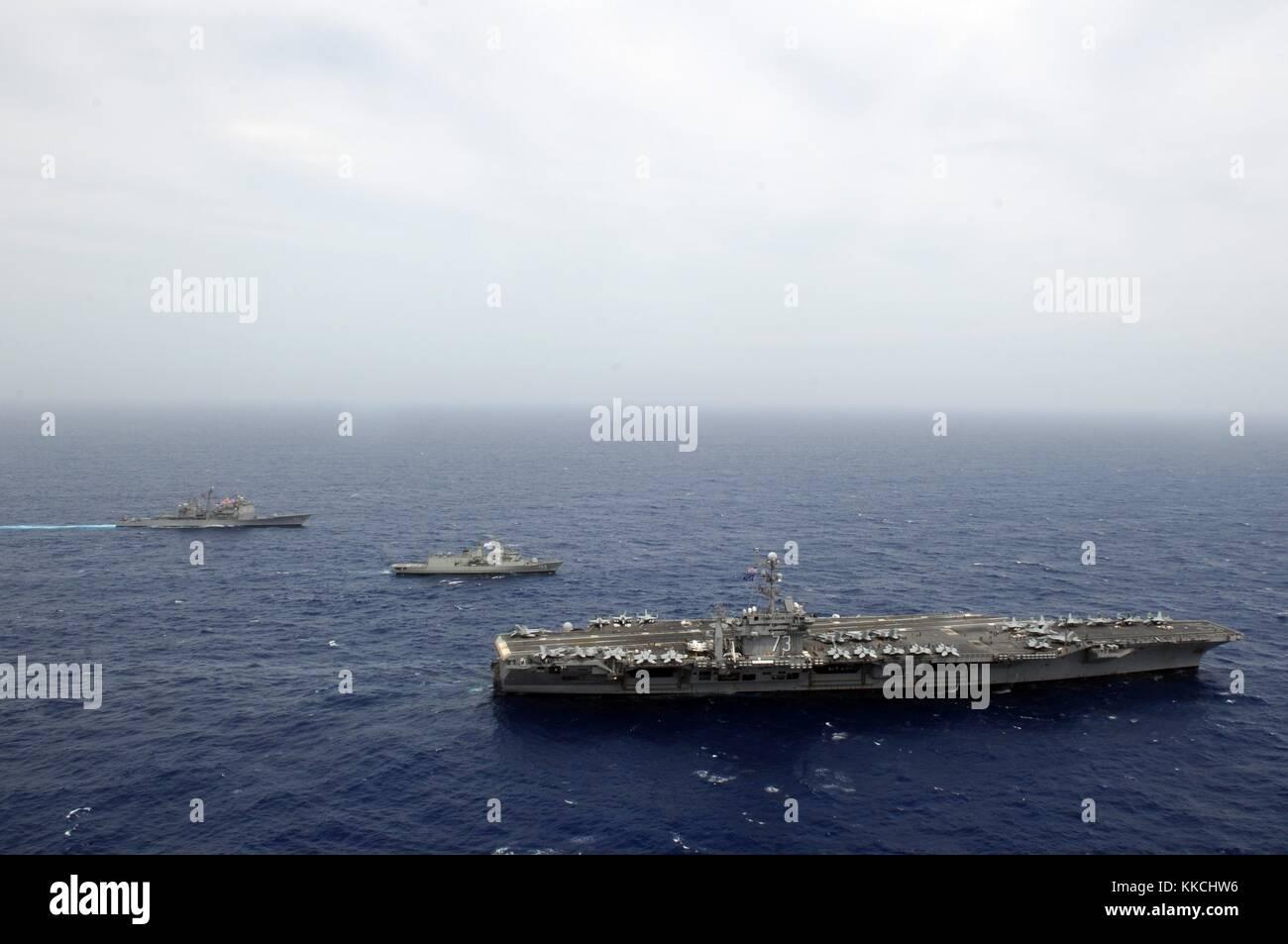 The Nimitz-class aircraft carrier USS George Washington CVN 73 is alongside the Royal Australian Anzac-class guided Stock Photo