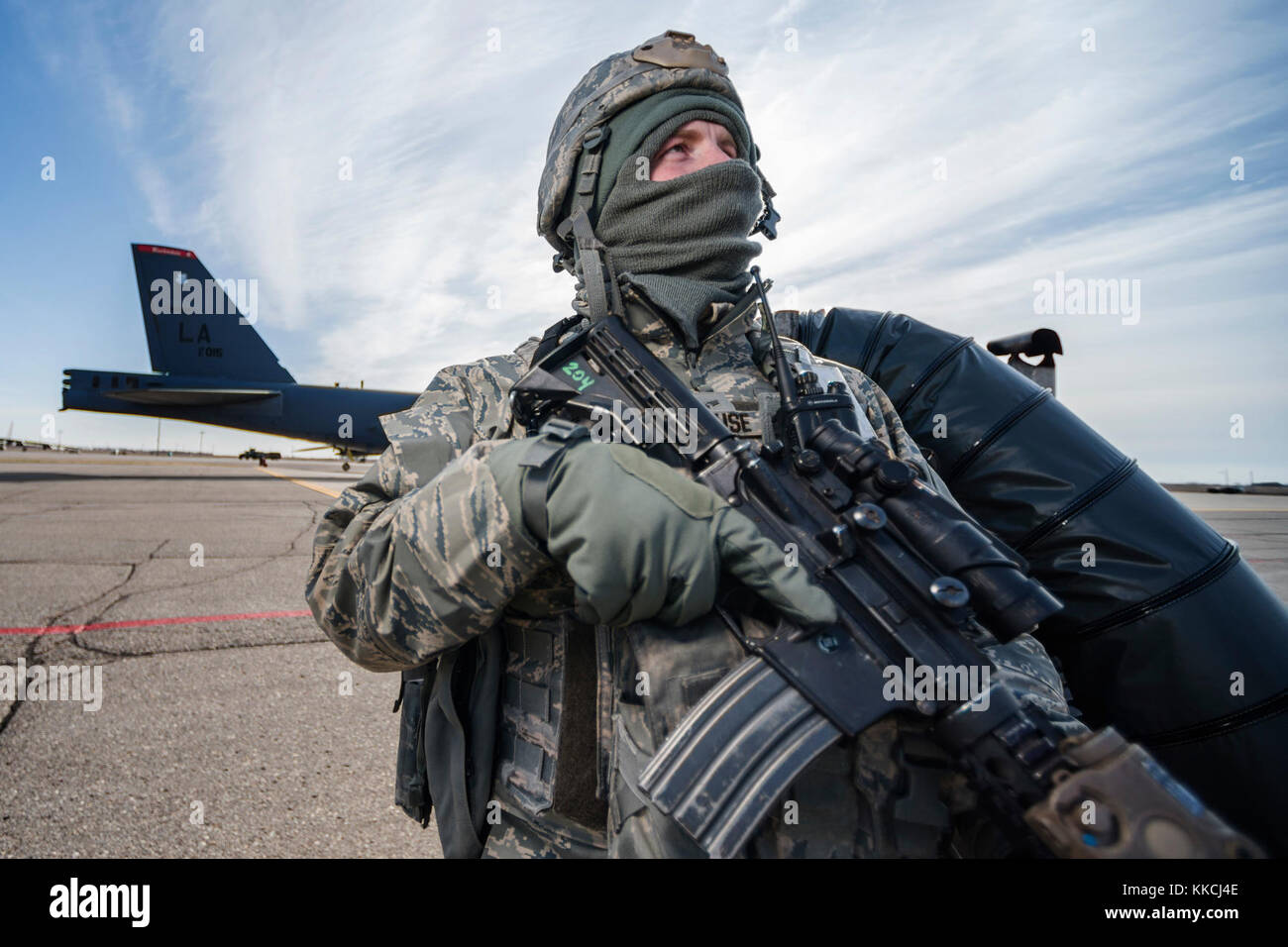 Airman 1st Class Joshua Prause, 377th Security Forces Squadron defender, stands guard at Minot Air Force Base, N.D., Stock Photo
