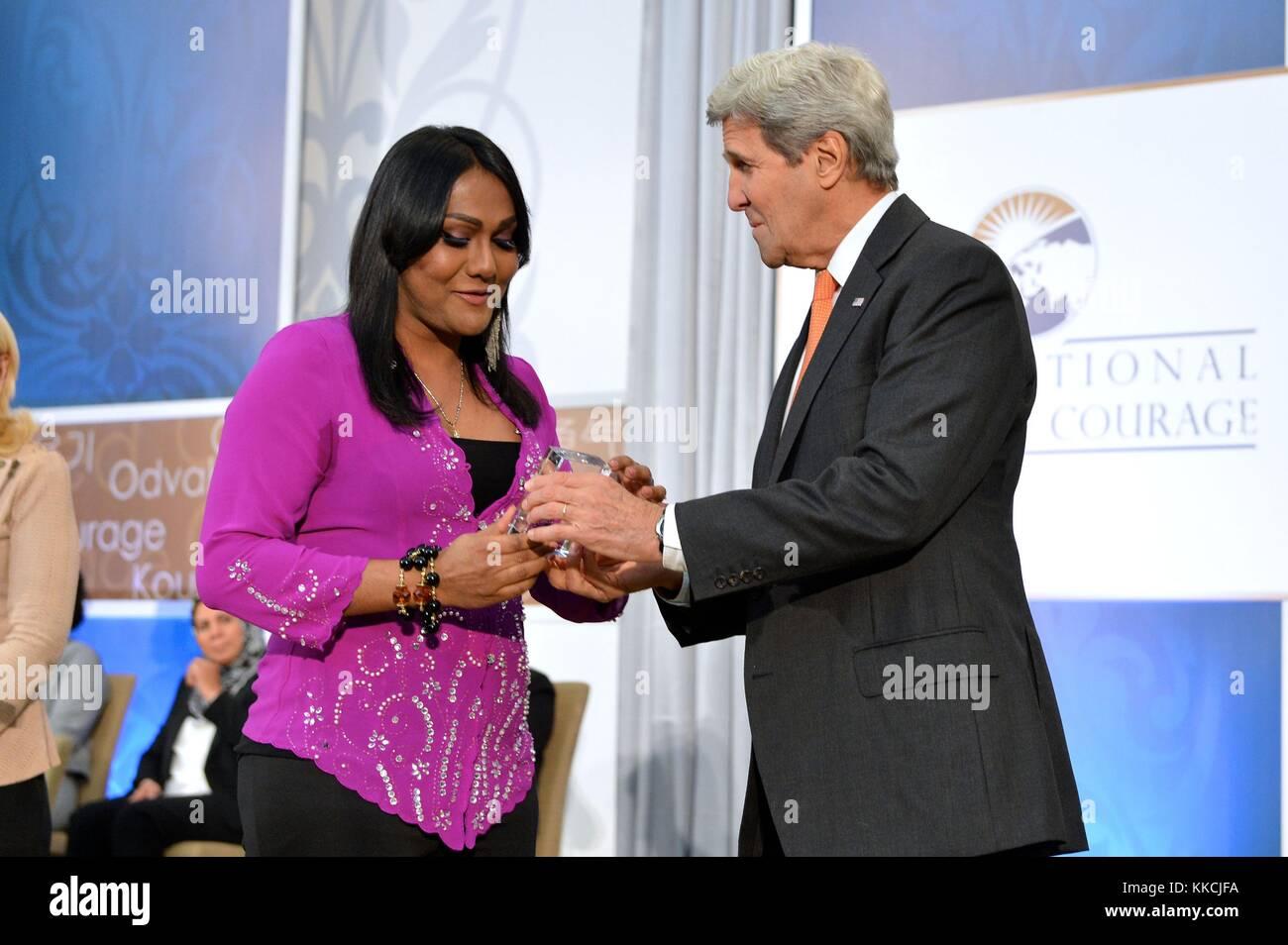 US Secretary of State John Kerry presents the 2016 International Women of Courage Award to Nisha Ayub of Malaysia, Stock Photo