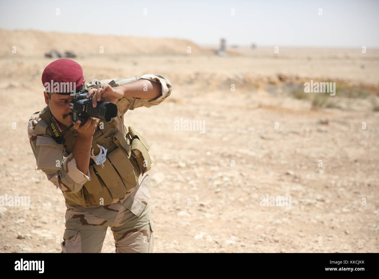 An Iraqi security forces soldier practices using his camera during media cell training at Al Asad Air Base, Iraq. - Stock Image