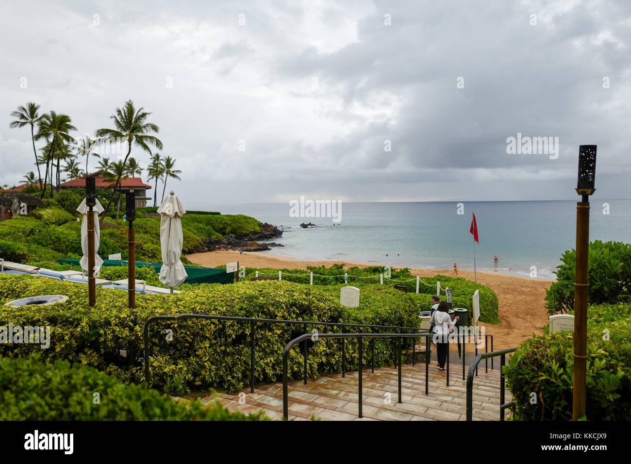 Rainy and overcast day at Wailea Beach, viewed from the terrace of the Four Seasons Resort Maui at Wailea, with - Stock Image