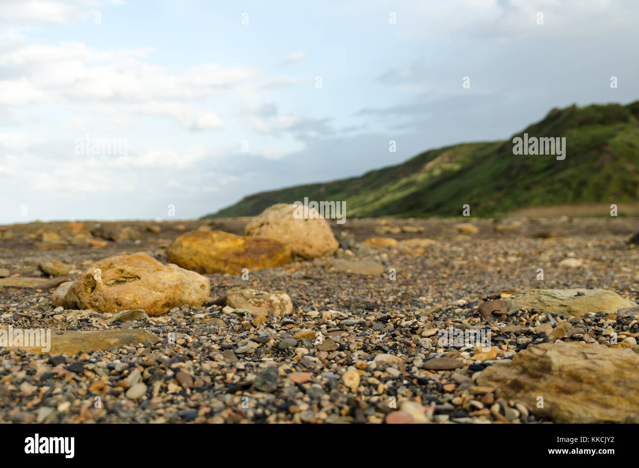 Rocks on Blast Beach, Dawdon, which are stained due to previous dumping of industrial waste - Stock Image