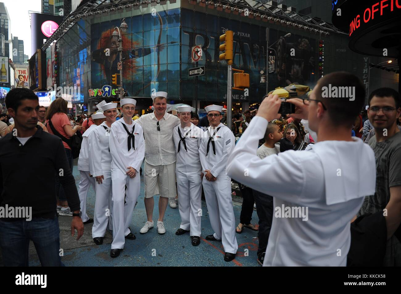 Sailors pose for photos during Fleet Week, New York. Image courtesy Mass Communication Specialist 1st Class Arif - Stock Image