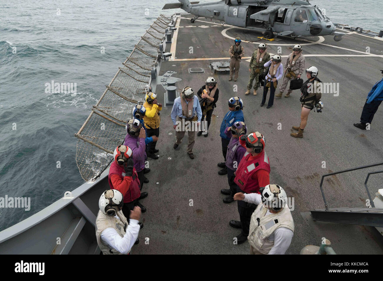ARABIAN GULF (Nov. 23, 2017) Secretary of the Navy Richard V. Spencer is saluted by side boys upon his arrival to - Stock Image