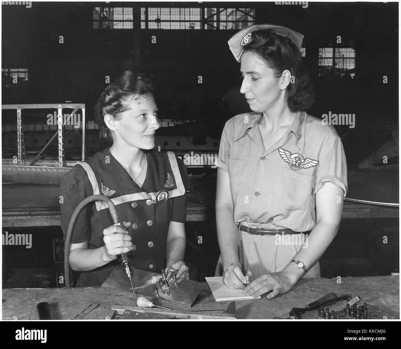 Pearl Harbor widows have gone into war to carry on the fight with a personal vengeance. Mrs. Virginia Young (right), - Stock Image