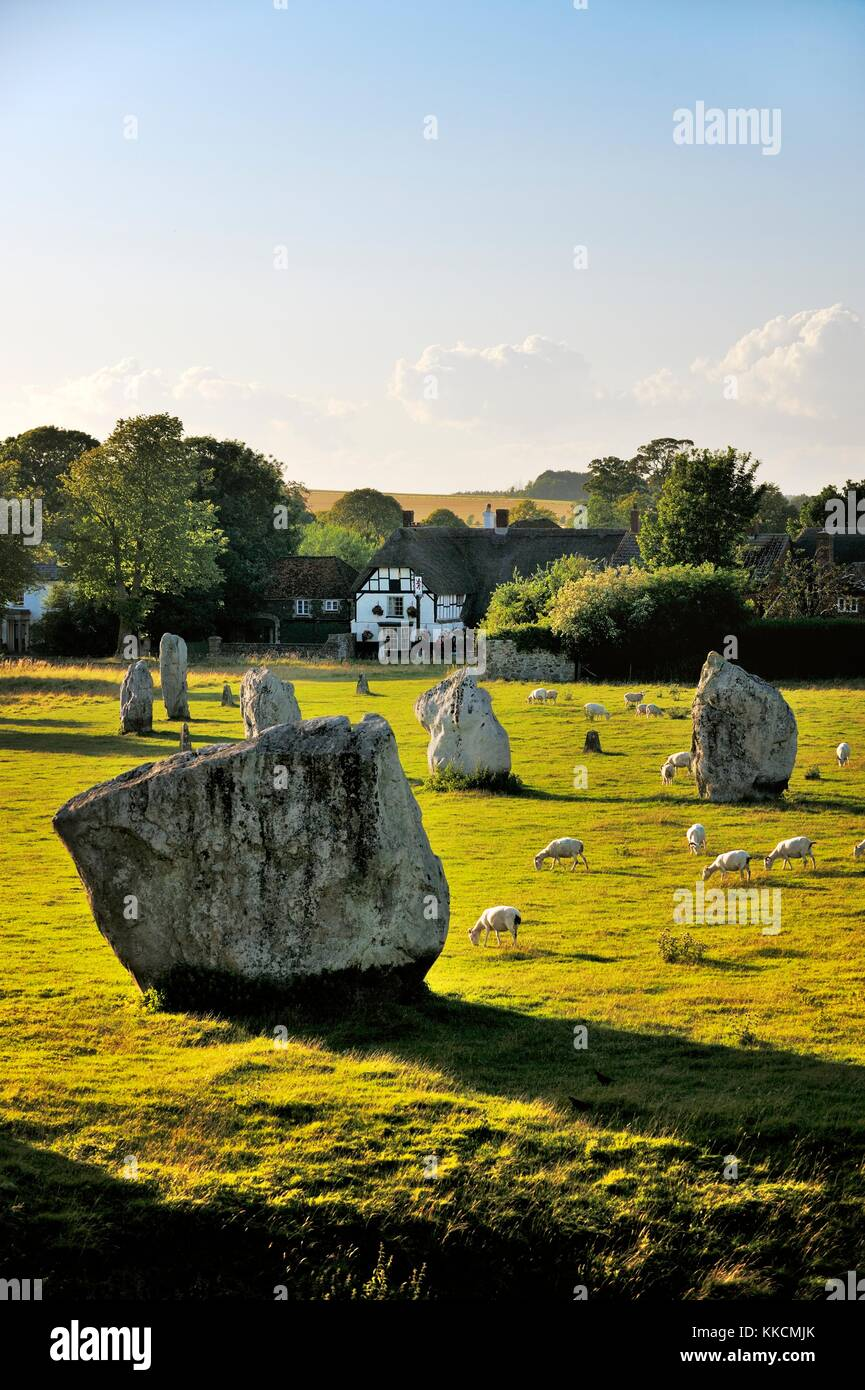 Avebury Neolithic henge and stone circles, Wiltshire, England. 5600 years old. Over inner South Circle toward village - Stock Image