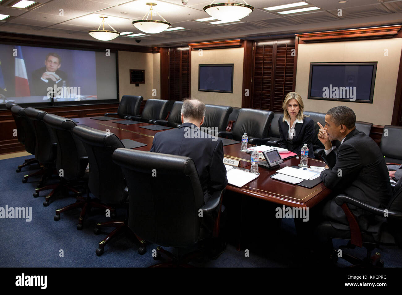 President Barack Obama participates in a video teleconference with President Nicolas Sarkozy of France, in the Situation Stock Photo