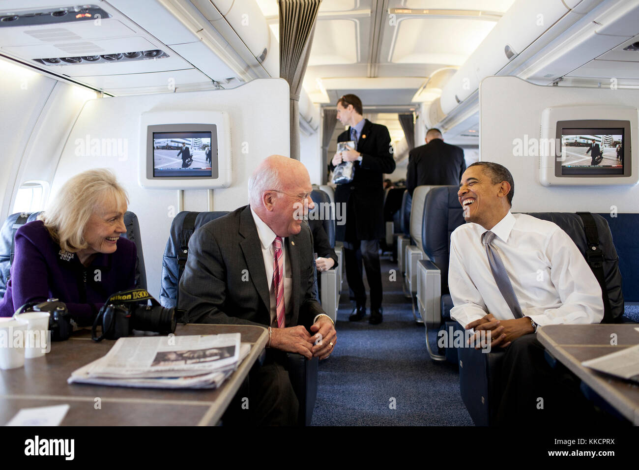 President Barack Obama talks with Sen. Patrick Leahy, D-VT, and Marcelle Leahy aboard Air Force One en route to Stock Photo