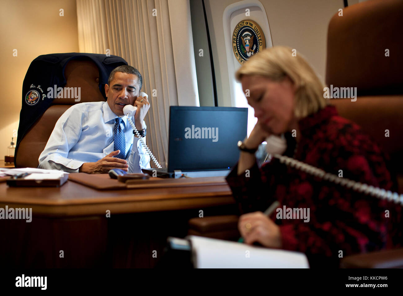 President Barack Obama talks on the phone with President-elect Vladimir Putin of Russia while aboard Air Force One Stock Photo