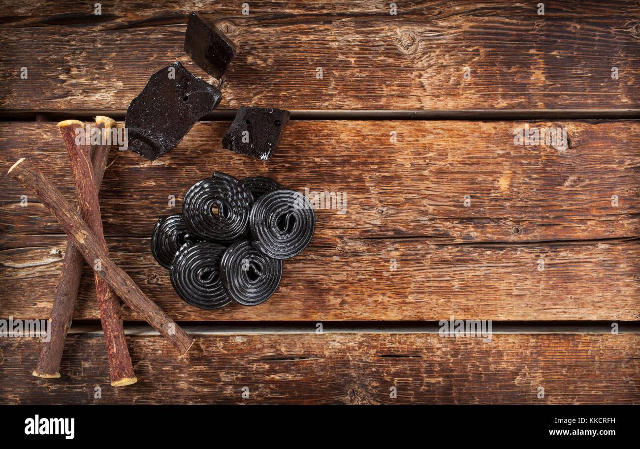 Production steps of licorice roots pure blocks and candy - Stock Image