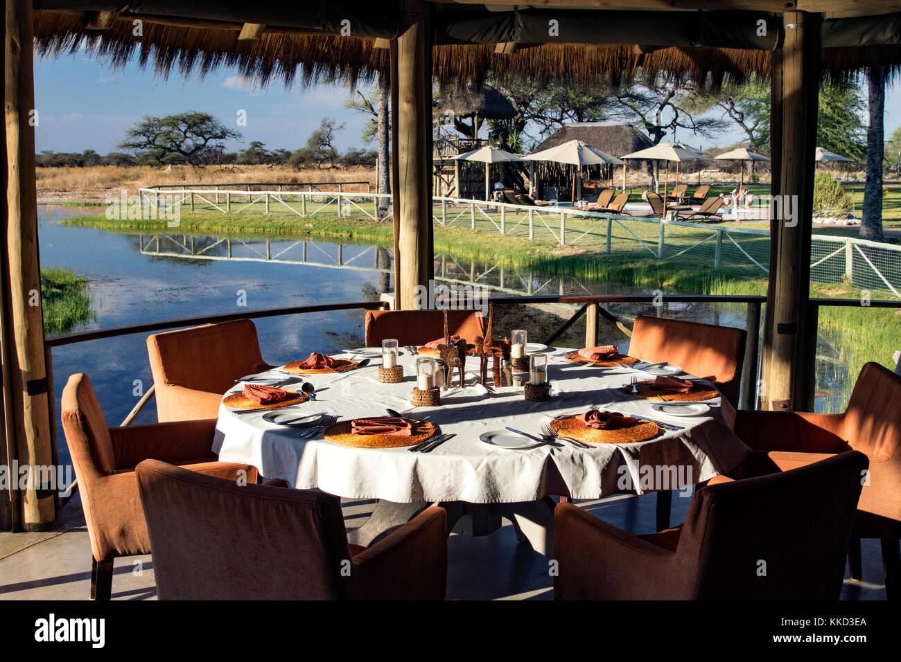 Outdoor dining at Onguma Bush Camp, Onguma Game Reserve, Namibia, Africa - Stock Image