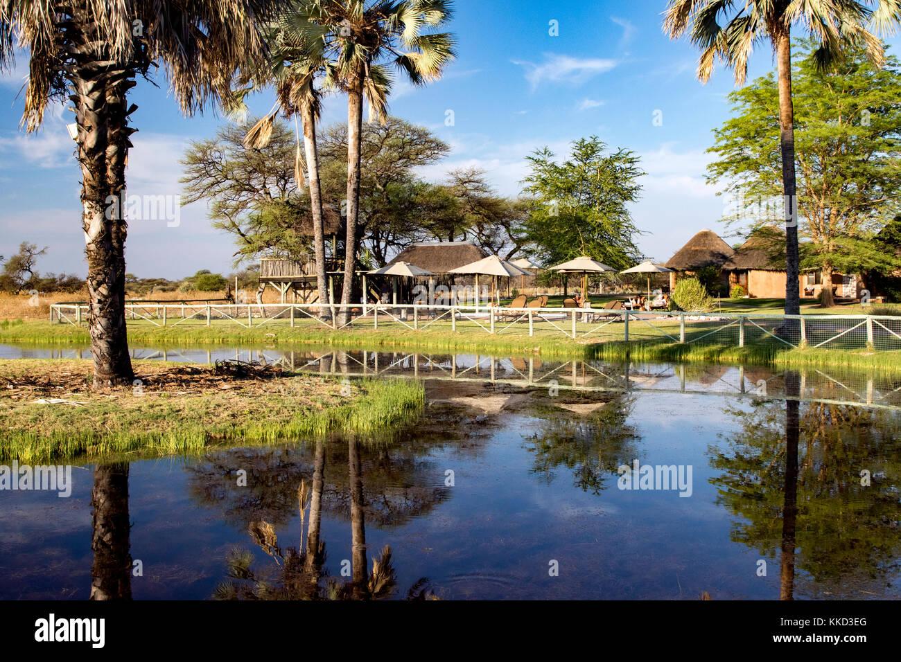 Waterhole at Onguma Bush Camp, Onguma Game Reserve, Namibia, Africa - Stock Image