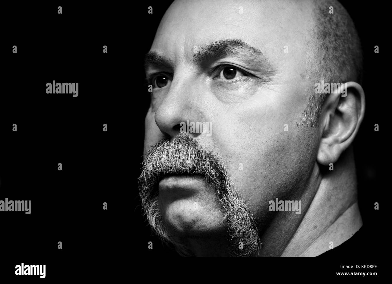 Head shot of a man with a handlebar moustache - Stock Image