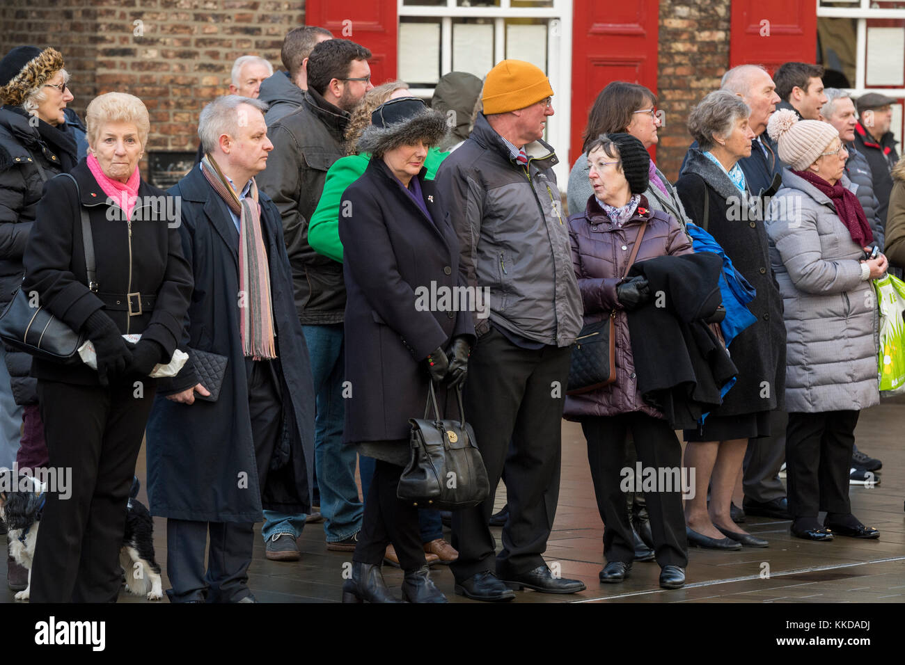 Close-up of people lining the route standing at side of road in the cold, before military parade outside York Minster - Stock Image